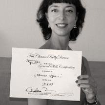 Jorunn proudly flashing the diploma